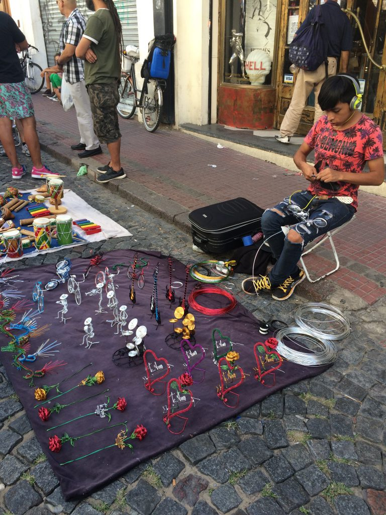 selling crafts at feria de San Telmo in Buenos Aires